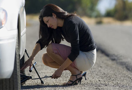 woman doing tyre change