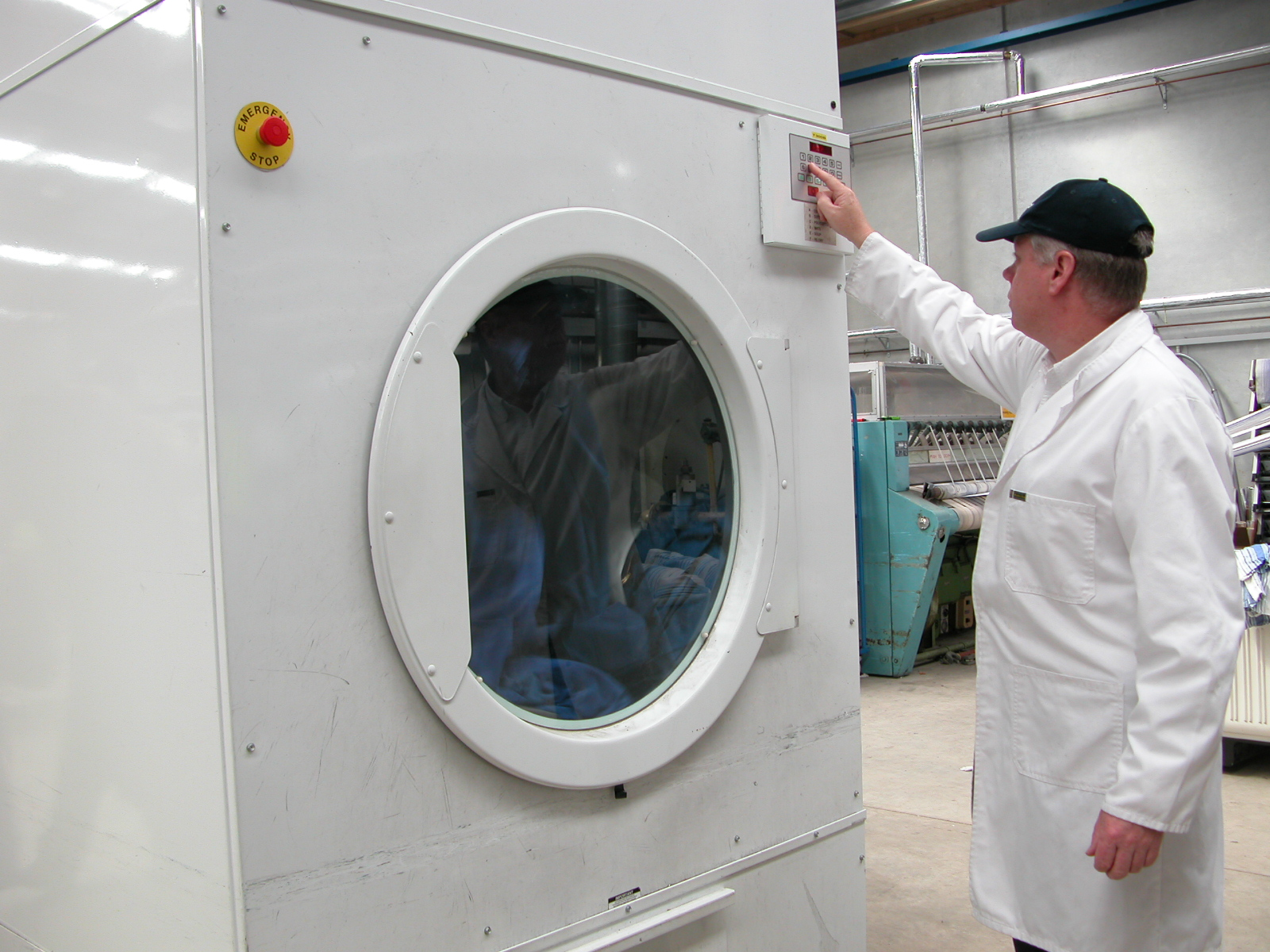 man operating big Laundry machine